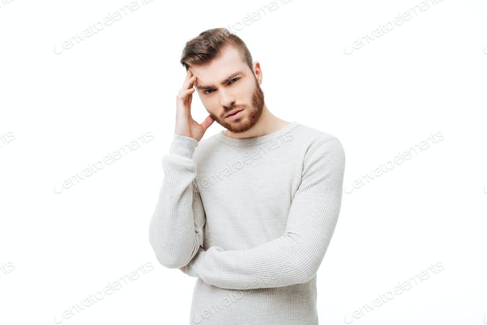 Young man with headache or thinking hand gesture isolated