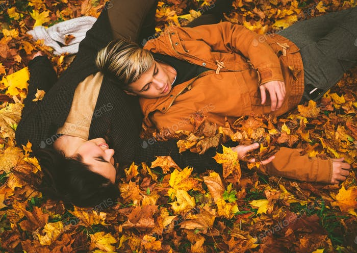 Lovely couple in autumn park
