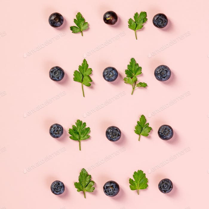Pattern of blueberry and parsley leaves, flat lay, top view