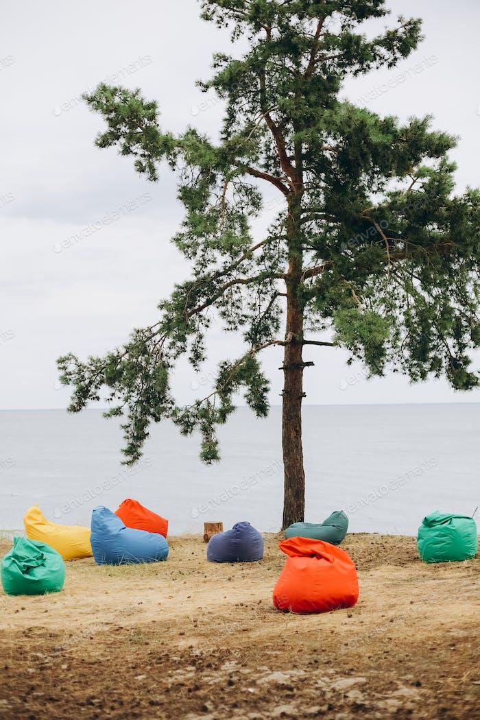 poufs multi colored seashore one tree send