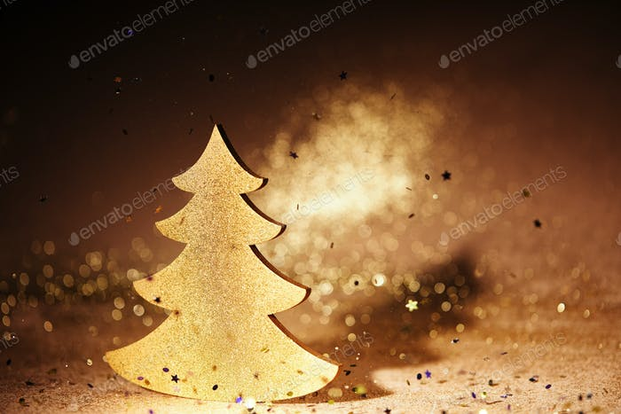 golden glossing christmas tree for decoration with falling sequins