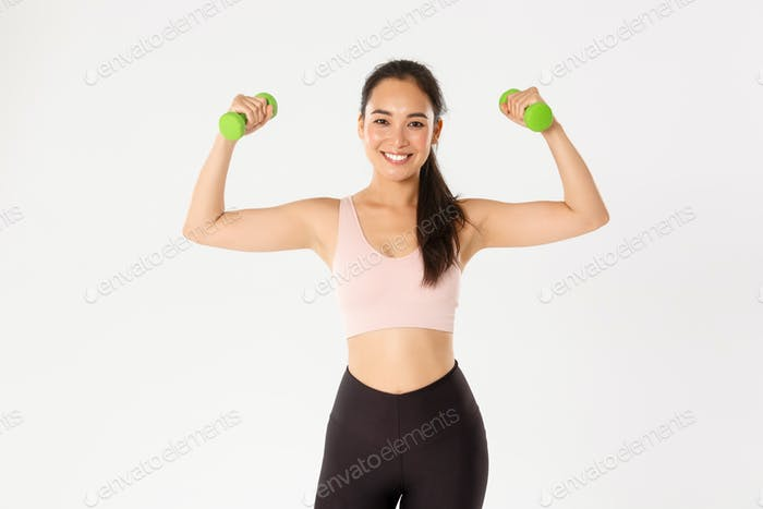 Fitness, healthy lifestyle and wellbeing concept. Portrait of strong and happy female athlete, asian