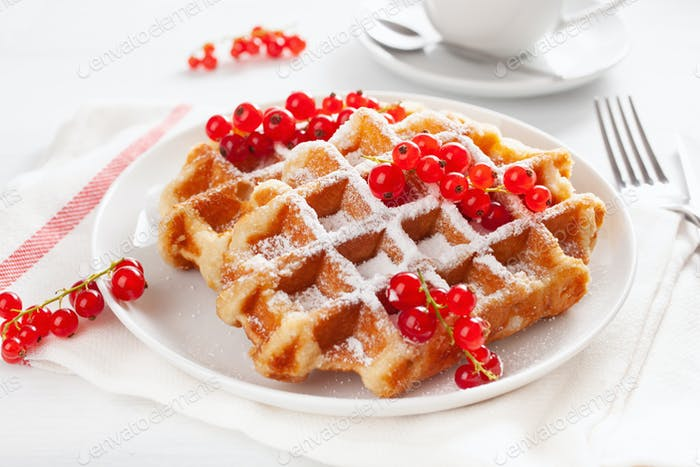 breakfast with waffle, berry and tea