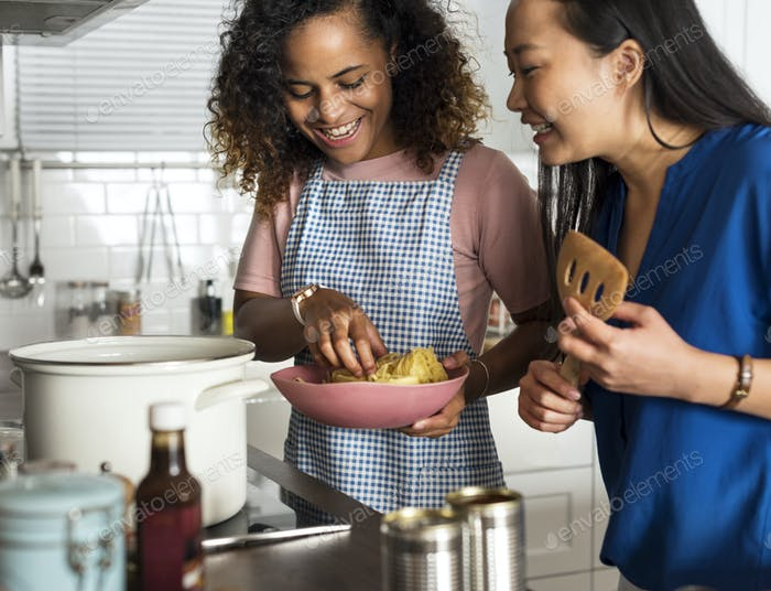 Diverse women cooking in the kitchen together