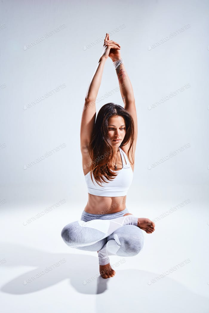 Woman doing yoga isolated on white background