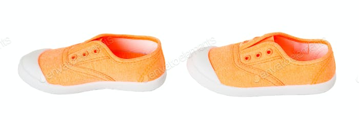 Baby girl orange fabric sneakers.