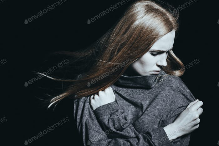 Depressed woman with mental disorder