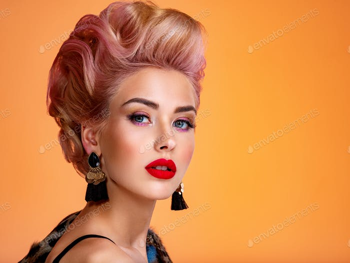 Beautiful woman with creative hairstyle, vivid makeup.