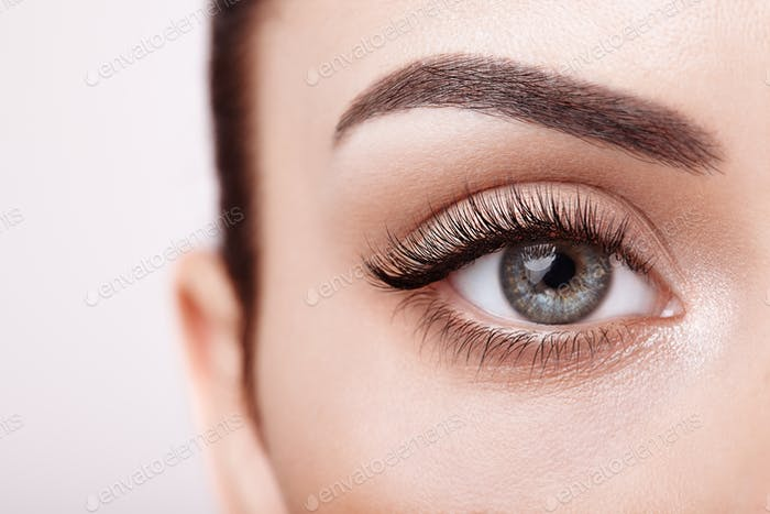 Female eye with long false eyelashes
