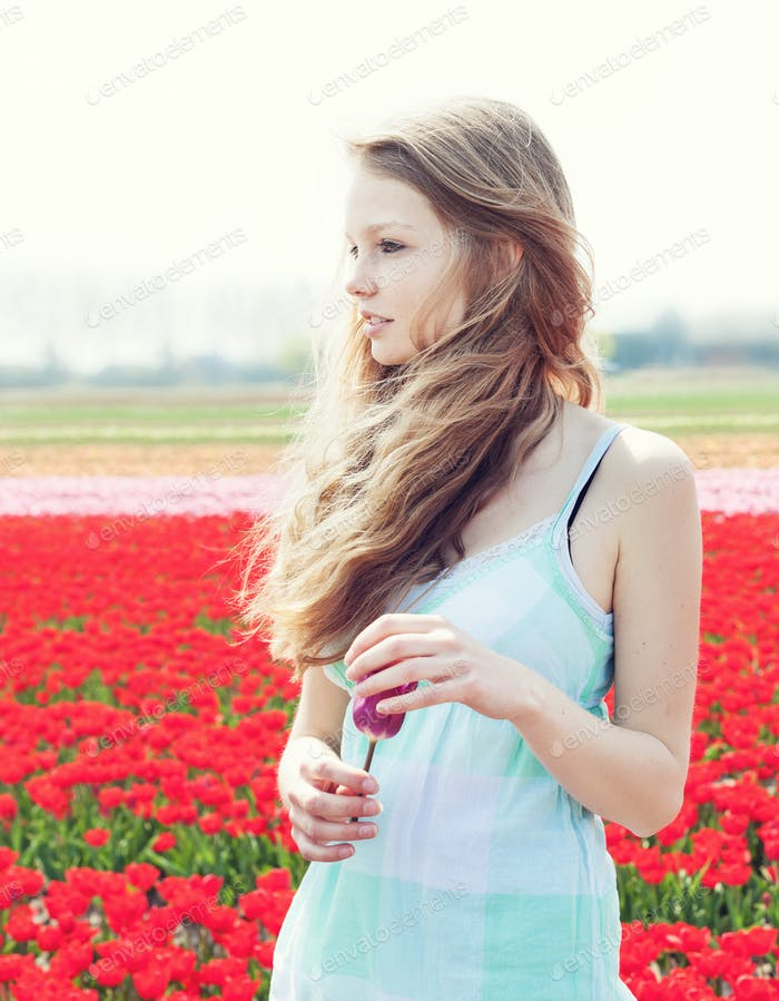 woman in red tulip field