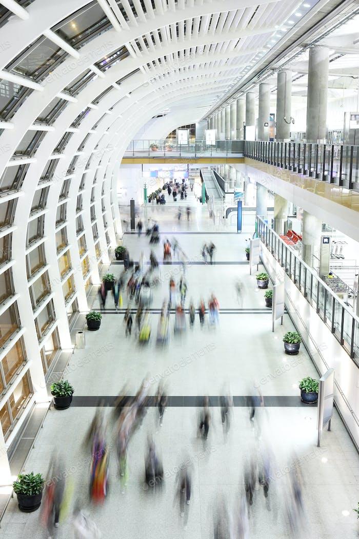 people moving blur in corridor
