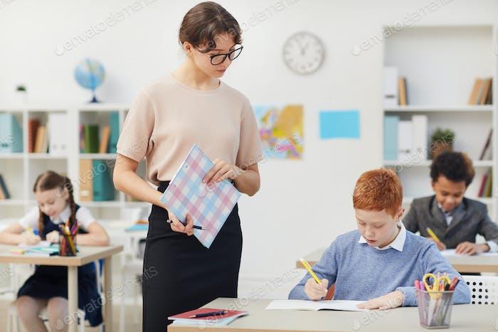 Teacher and school children at school
