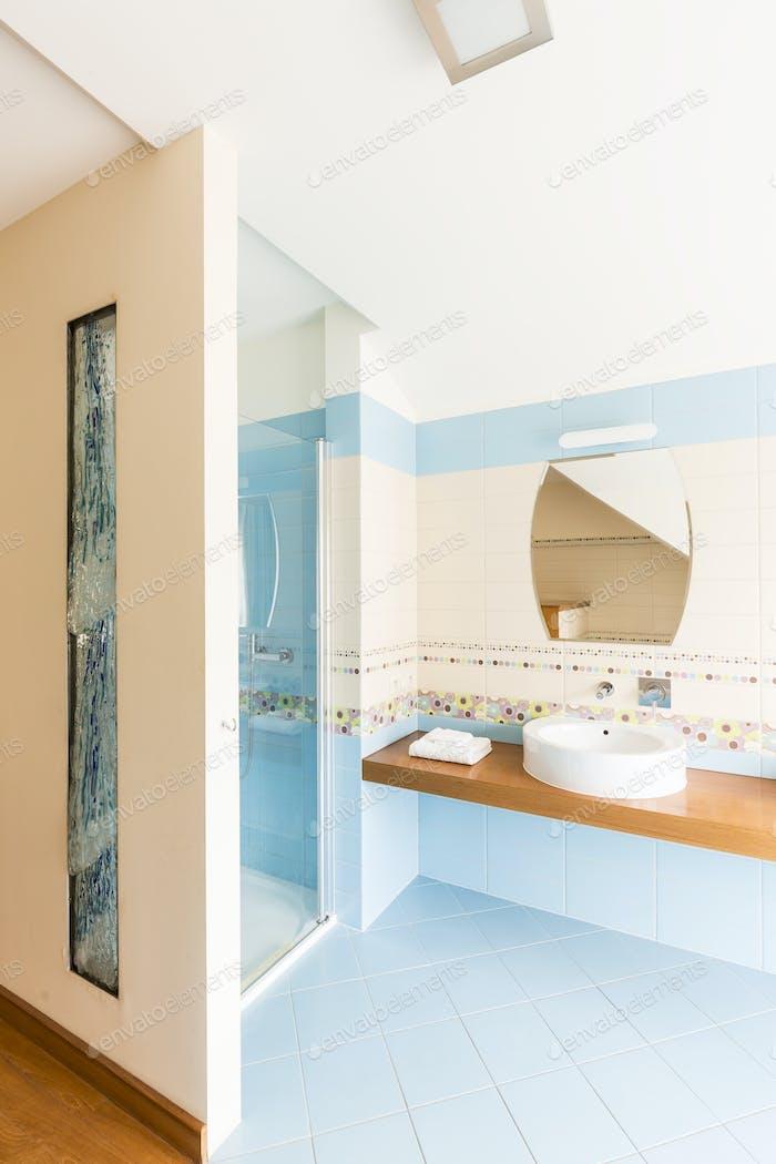 Modern bathroom with blue tiles