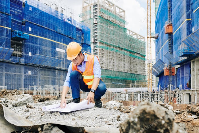 Civil engineer working outdoors at constrution site