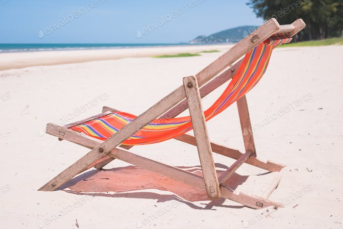 Red canvas chair on the beach.