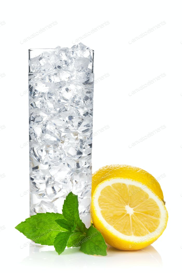Glass of water with ice, lemon and mint
