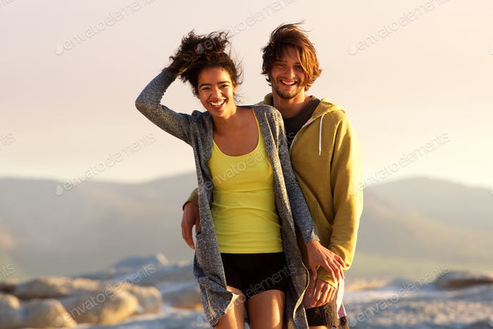 Handsome young man and smiling woman outdoors