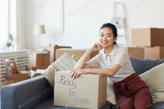 Smiling Asian Woman Ready to Move