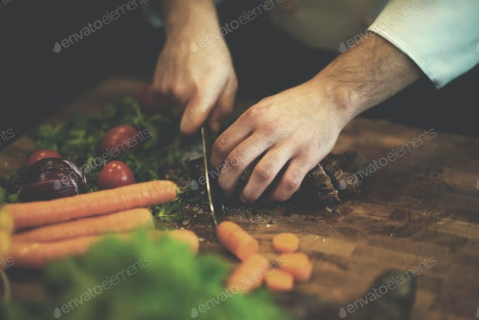 closeup of Chef hands preparing beef steak
