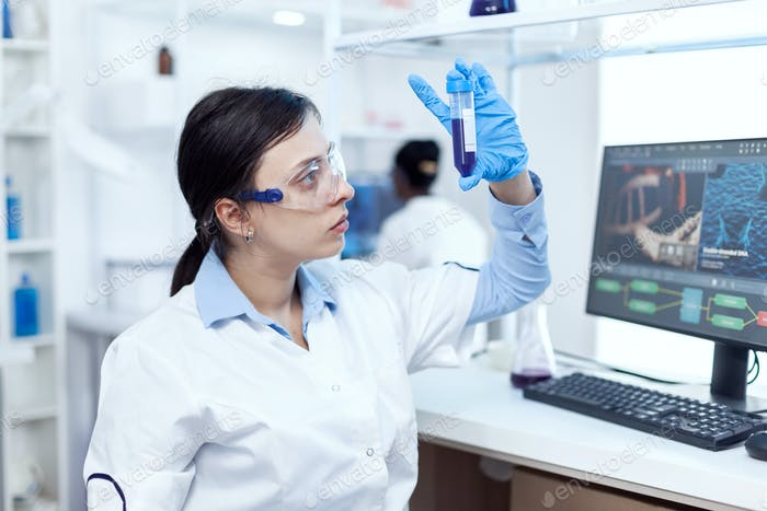Close up of young doctor in biochemistry analysing genetic material