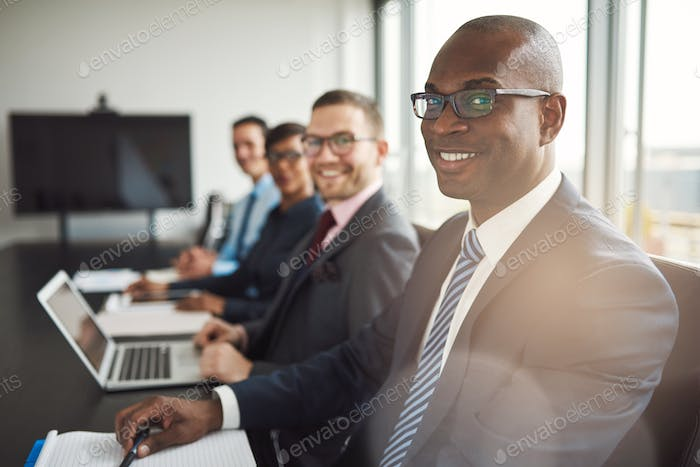 Smiling confident African businessman in a meeting