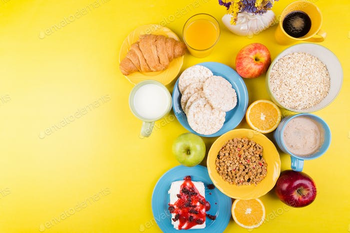 Healthy Breakfast. Various Assortment Set. Orange Juice, Granola, Croissant, Coffee and Fruit.