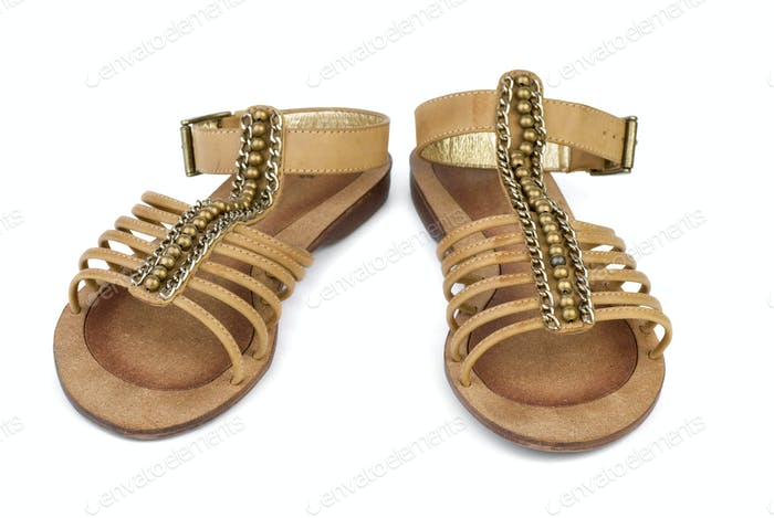 Pair of brown leather female sandals