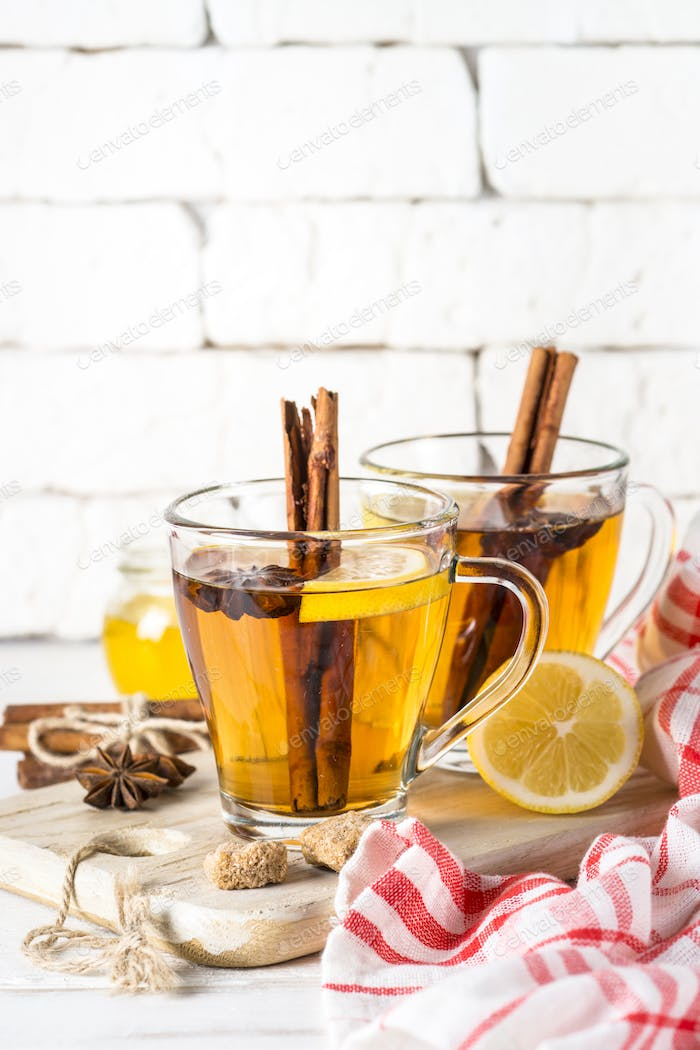 Autumn hot tea with lemon and spices