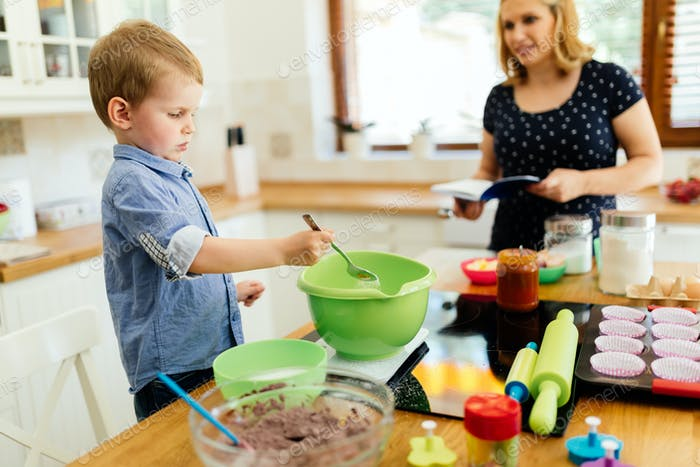 Child helping out in kitchen