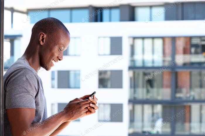 smiling black man using cellphone