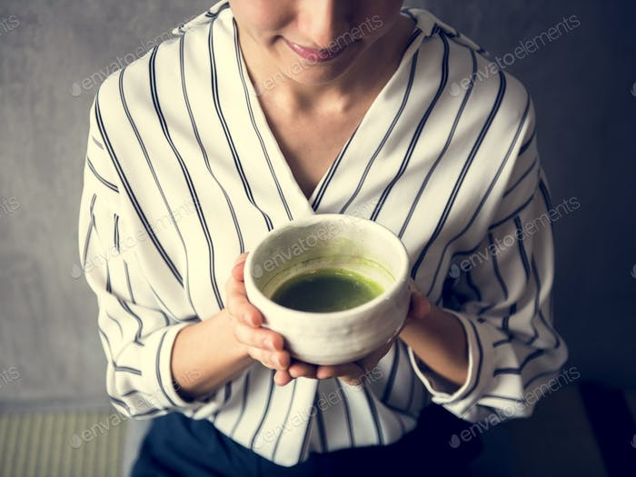 Woman making oriental green tea japanese ceremony