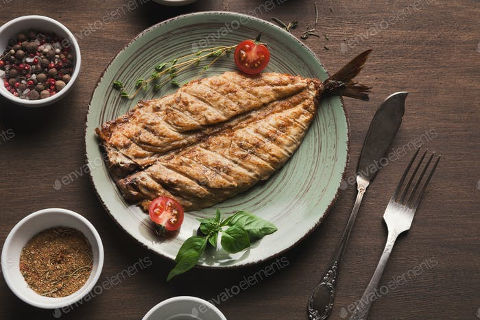 White fish juicy fillet grilled on barbecue