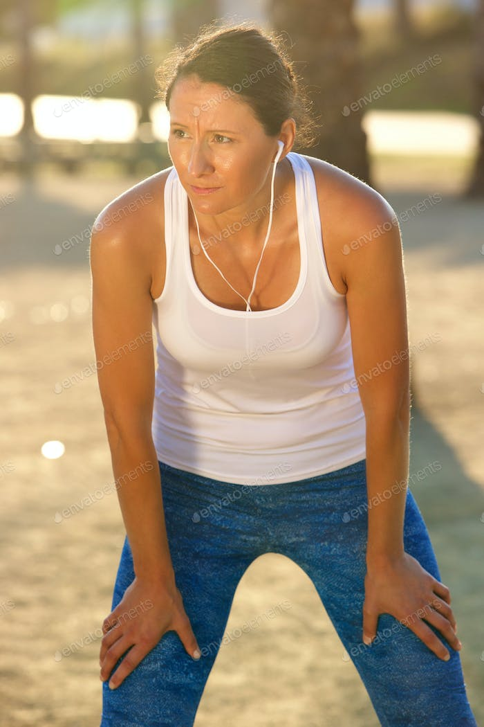 Active older woman resting after workout