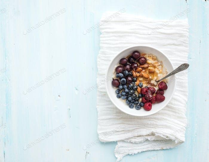 Healthy breakfast set. Bowl of oat porridge with fresh berries