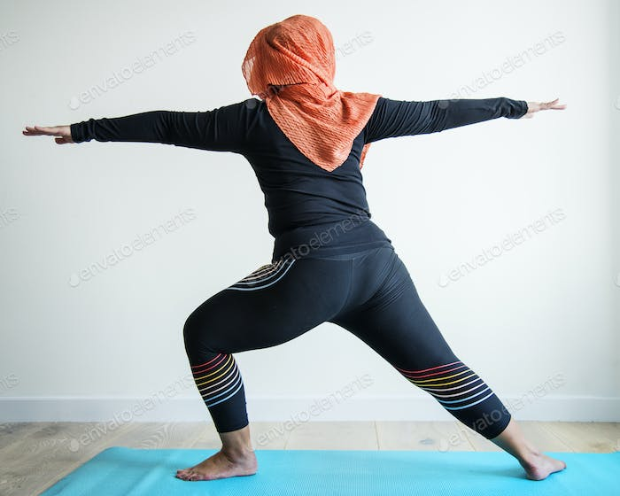 Islamic woman doing yoga in the room