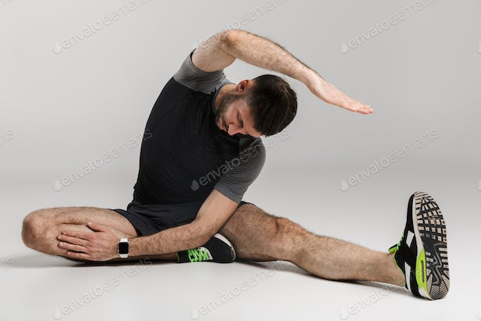 Image of caucasian athletic man doing exercise while working out