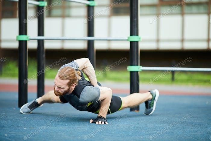 Twisting body while doing push-ups