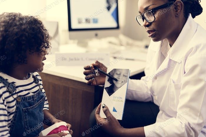 African kid having a conversation with a doctor