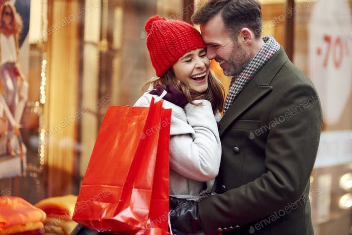Romantic moment of couple during Christmas shopping