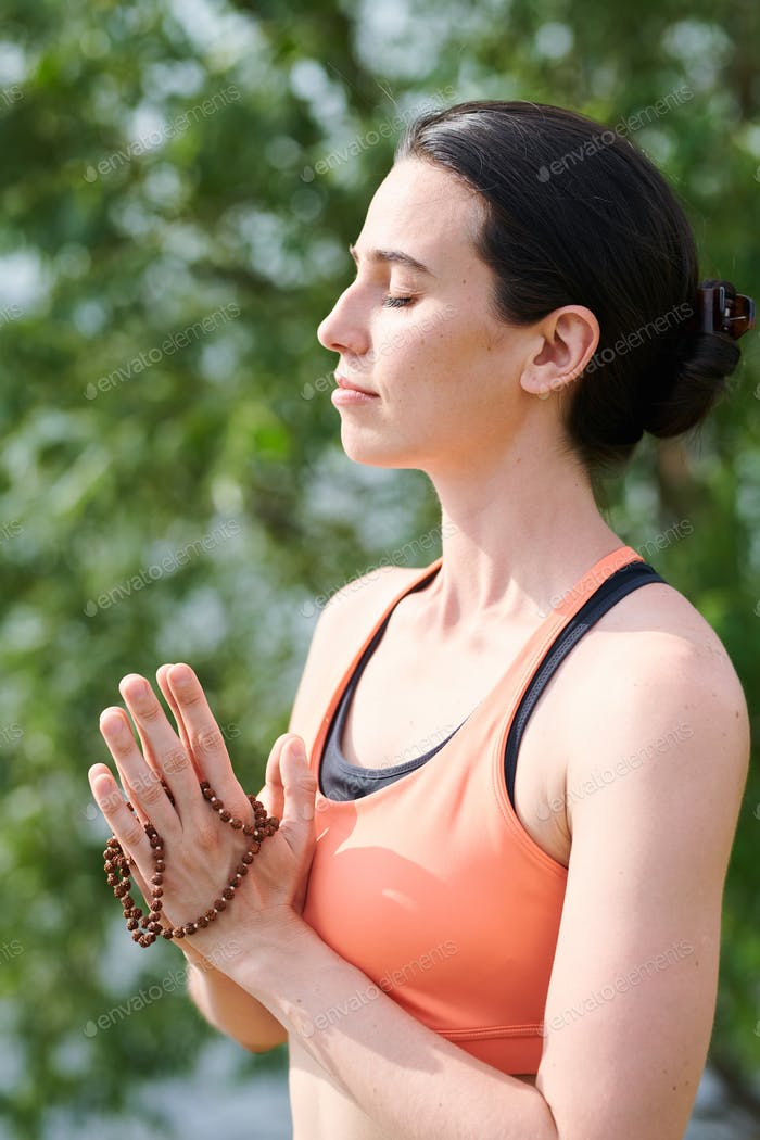 Meditating with yoga mala beads