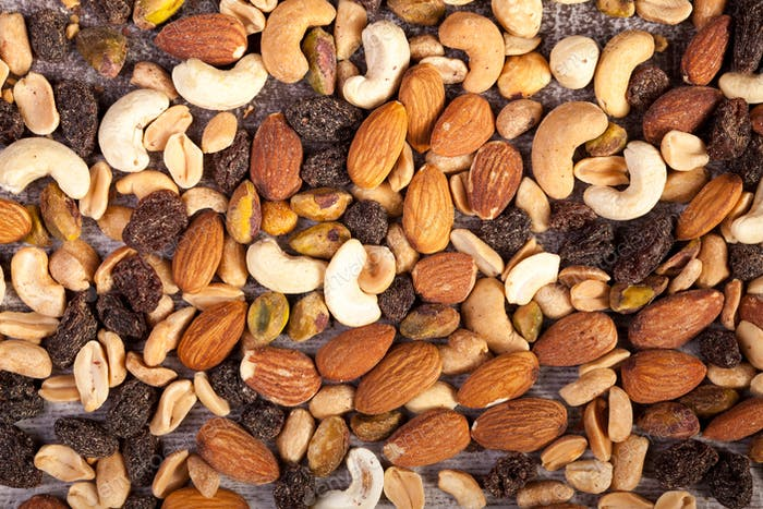 Close up of Mix of healthy raw nuts on wooden background