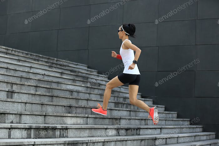 Runner running up on city stairs