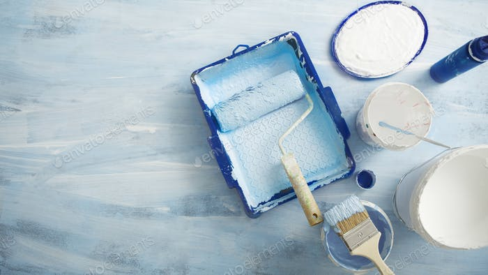 Painting tools for renovation on blue background