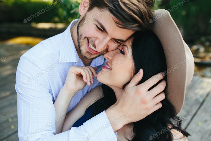 man embracing his girlfriend