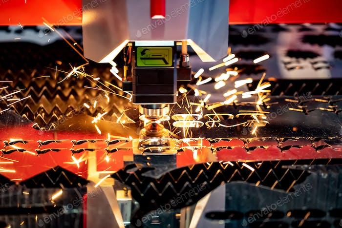 CNC Laser cutting of metal, modern industrial technology.