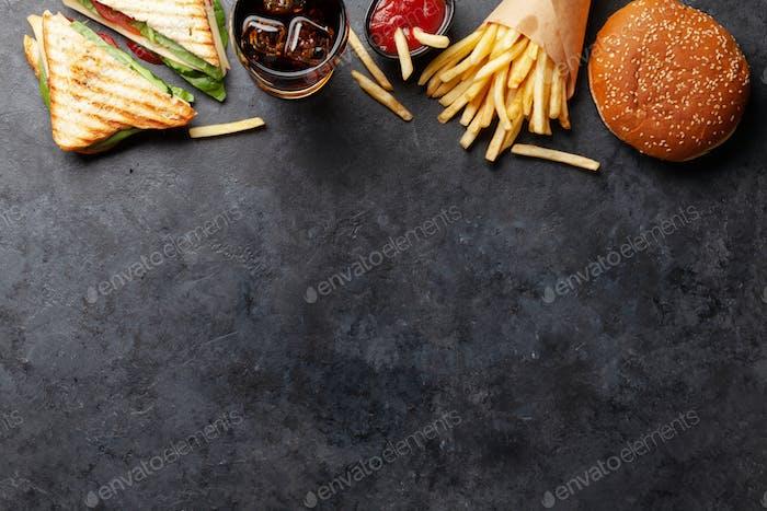 Club sandwich, potato fries, hamburger and cola