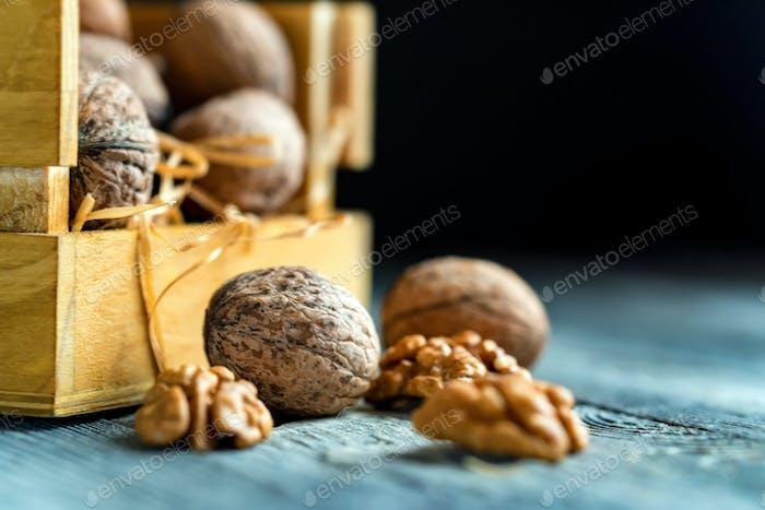 Walnuts in box on wooden backgound