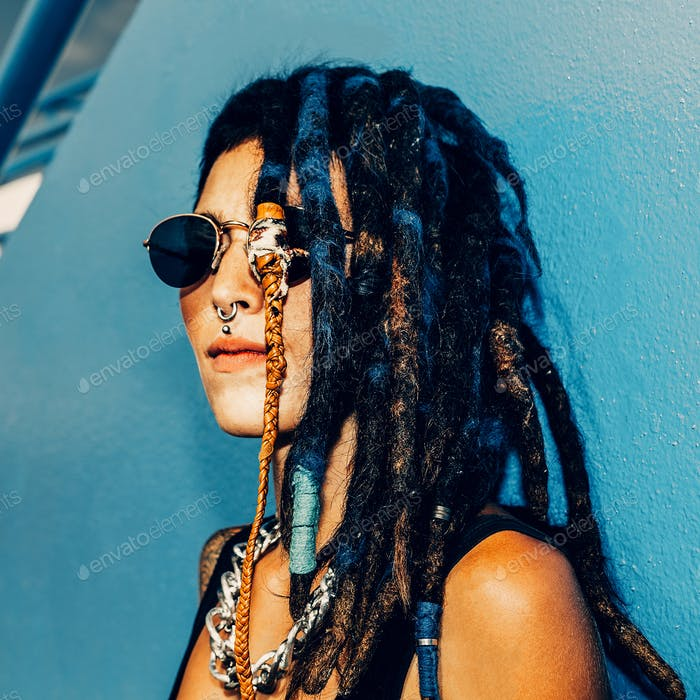 Rasta Spanish Girl with dreadlocks, piercings, tattoos and styli