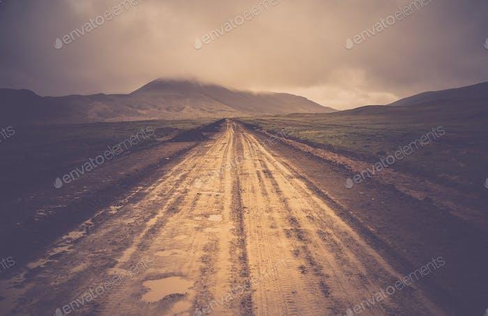 Muddy mountain road  in TIbet