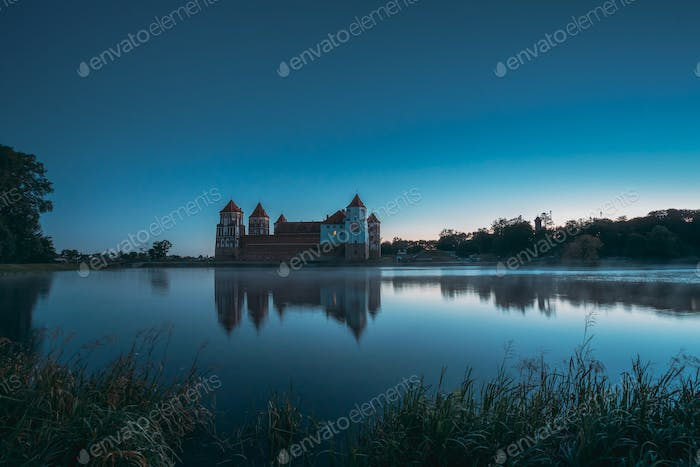 Mir, Belarus. Mir Castle And Lake During Early Summer Morning Ti
